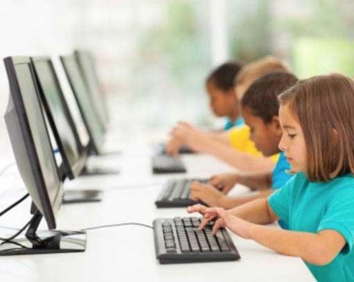 kids typing on keyboard