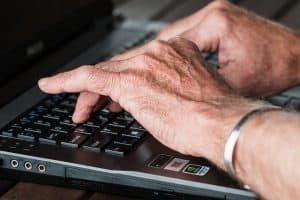 seniors typing keyboard
