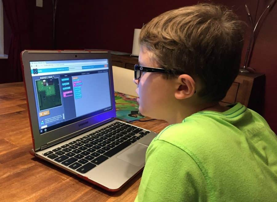 kid learning computer programming